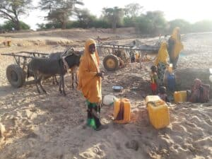 Qurac damer community waiting for water yeild from an oasis of dried river dawa in Dollow Somalia 2019 drought Gedo
